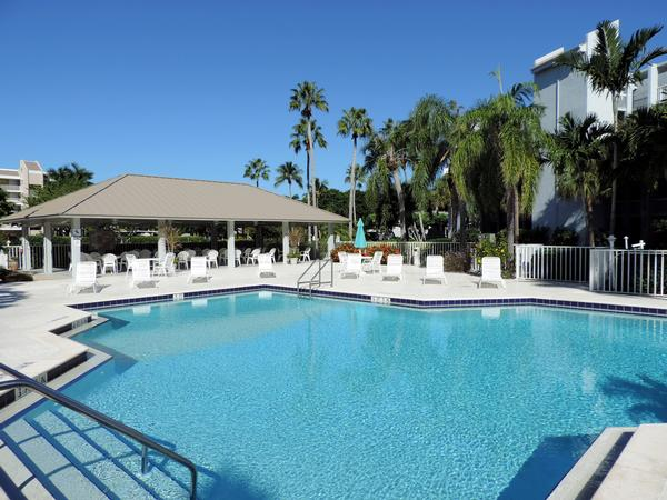 Large heated pool next to condo